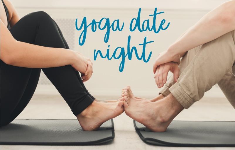 close cropped image of couple on yoga mats sitting toe to toe