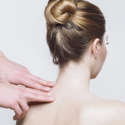 therapist pressure pointing sore shoulder/neck