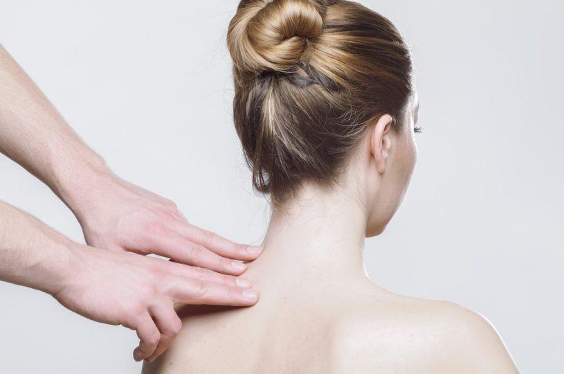 therapist pressure pointing sore shoulder/neck