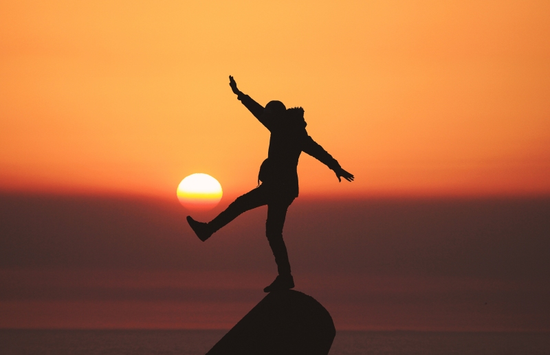 silhouette of person balancing on one foot