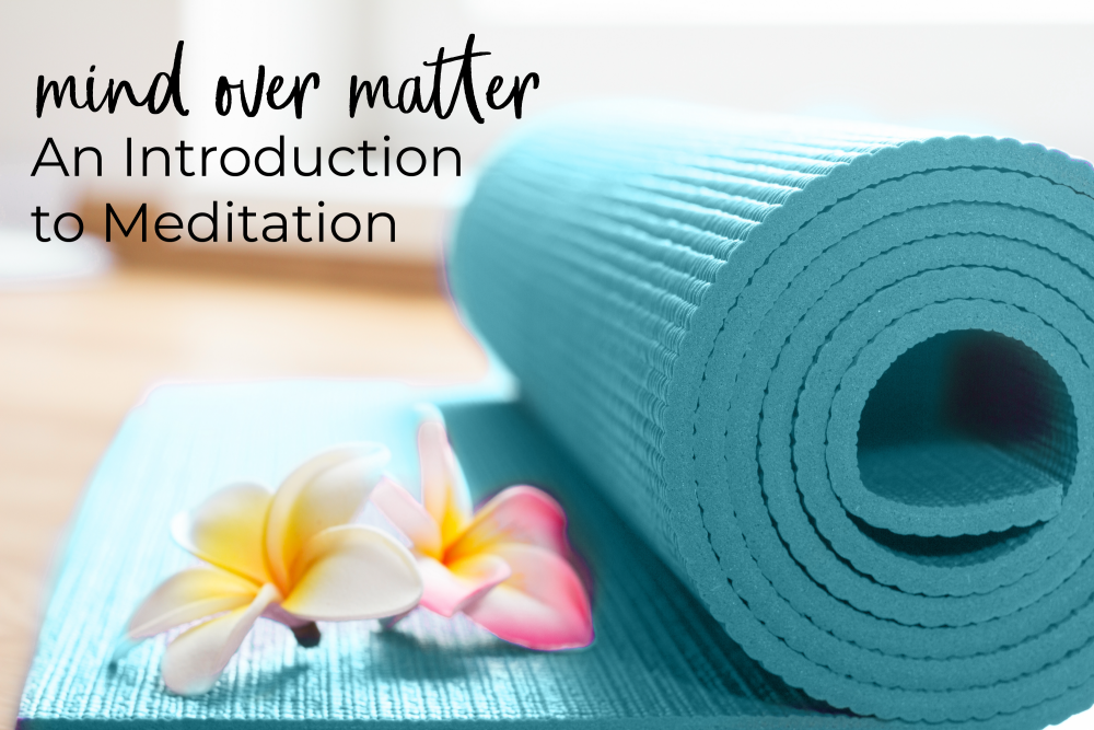 rolled up yoga mat with flowers and workshop title
