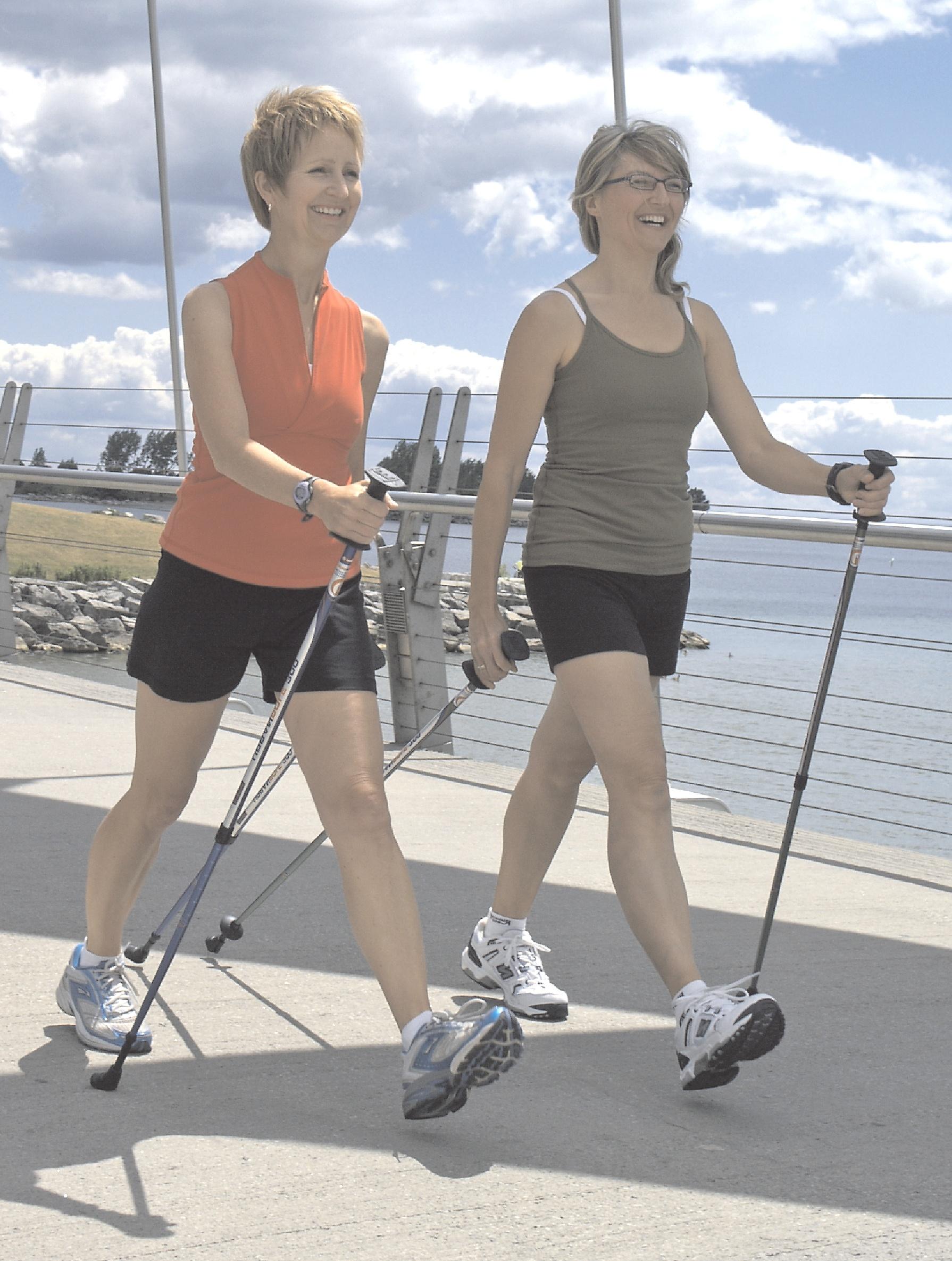 2 women walking with nordic poles