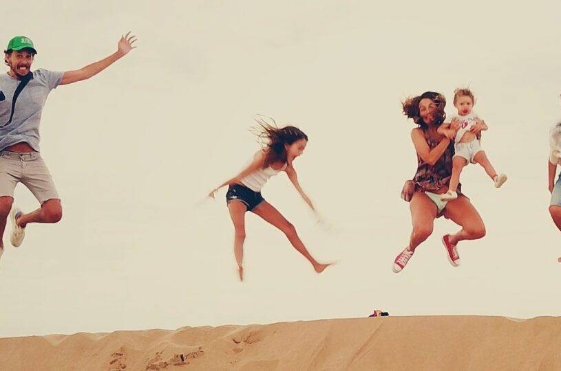 Active family jumping in the air