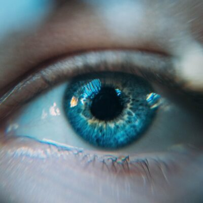 close up of woman's blue eye